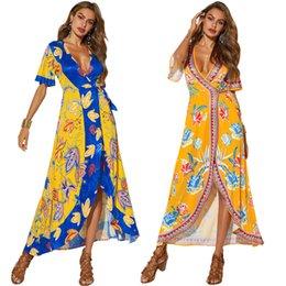 $enCountryForm.capitalKeyWord Canada - Cross-border European and American short-sleeved women's beach skirts sexy V-neck split-forked holiday print dresses