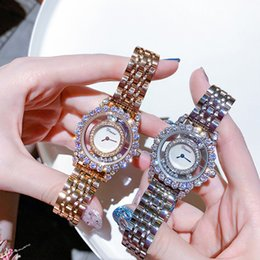 $enCountryForm.capitalKeyWord Australia - Top Quality Brand Women Rhinestone Watch High-grade Lady Shining Rotation Dress watch Big Diamond Steel strap bracelet Watches