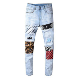 men star print jeans NZ - 2020 New Men's stars printed leopard patchwork rivet slim jeans Light blue holes ripped skinny stretch denim pants Trousers