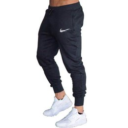 Leopard men s pants online shopping - New Brand Print logo Gyms Men Joggers Casual Men Sweatpants Joggers Pantalon Homme Trousers Sporting Clothing Bodybuilding