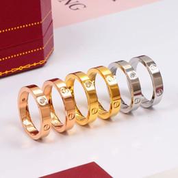 venda por atacado amantes Designer Titanium Marca casamento anel de aço para as mulheres Luxo CZ Zirconia ouro rosa homens anéis de noivado jóias presentes PS8401