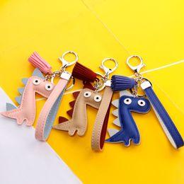 Keys Bell Australia - Car keychain dinosaur pendant Japanese and Korean cute luggage fashion pendant creative bell tassel key chain H049