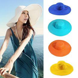 2cbfbf362ff18 Women Beach straw hats Sun Hat 2019 Summer Ladies Wide Brim Straw Hats  Outdoor Foldable Beach Panama Hats Church Hat 15 colors C01