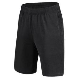 Venta al por mayor de Los últimos 2019 pantalones cortos transpirables de fitness para hombre, pantalones sueltos de entrenamiento, cinco puntos para correr, pueden ser deportivos o de moda y de ocio.