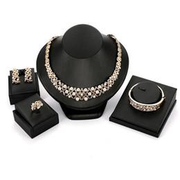 Imitation Pearl Jewelry Sets Australia - Earrings Necklace Bangle Ring 4-Piece Set Jewelry Luxury Elegant Rhinestone Imitation Pearl Hollow Out 18K Gold Plated Wedding Jewelry JS564