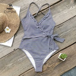 577a81a1a5bc3 Cupshe Navy And White Striped One-piece Swimsuit Women Ruffle Tied Bow  Monokini 2018 Backless Beach Bathing Suits Swimwear J190519