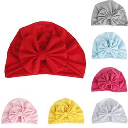 a39632265b3 Baby Boy Girl Accessories Neonato Bambino Beanie Solid Bow Knot Wrap Cap  Stile di moda Turbante Hat Y