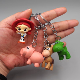 $enCountryForm.capitalKeyWord Australia - Cartoon Anime Keychains Pendant Cell Phone Charm A Set of Four Toys Accessories Story Strawberry Bear Hug Dragon Bass Doll Key Chains