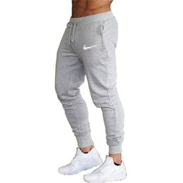 Wholesale black white patterned pants for sale - Group buy 2019 New Fashion Tracksuit Bottoms Mens Casual Pants Cotton Sweatpants Mens Joggers LOGO Printed Pants Hip hop Clothing