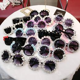 Ingrosso 25 stili delle ragazze dei bambini dei ragazzi Pearl fiore occhiali da sole della spiaggia dei bambini Forniture UV Occhiali protettivi donne di modo Ombrelloni Occhiali