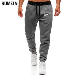 China 2019 High Quality Jogger Pants Men Fitness Bodybuilding Gyms Pants For Runners Brand Clothing Autumn Sweat Trousers Britches cheap high quality wholesale clothes suppliers