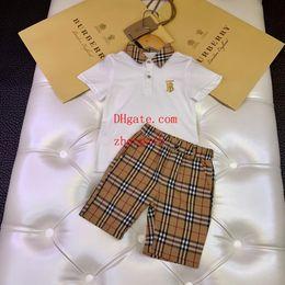 $enCountryForm.capitalKeyWord Australia - kids clothes boys girls Two-piece set print outfits lapel t shirt top + lattice printing shorts 2pcs set summer Boutique kids Clothing
