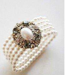 Großhandel Heißer verkauf elegante 5 stränge perle strass oval icon elastische armband b66