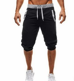 knee length pants for men UK - 2019 gym new fashion personality men's Five-minute Pants for Body-building and Fitness by Explosive Leisure Sports gym shorts