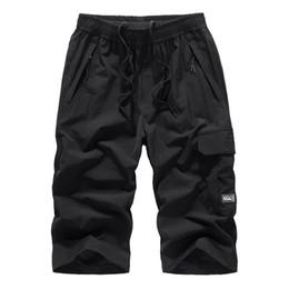 Drawstring Trousers Australia - Men Plus Size Trousers Jogger Pants For Men Drawstring Casual Solid Pocket Calf-Length Trousers Loose Straight pants 2019