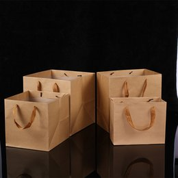 paper clothes NZ - Wholesale kraft paper bag clothing gift bag advertising tea shopping bag kraft paper