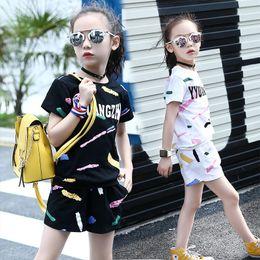 Girls Graffiti Shorts NZ - The New Summer Girls Clothing Tidal Range of Leisure in Kid Children Graffiti Short Sleeve T-shirt Shorts Two Piece Set