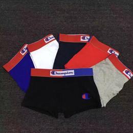 233d51fea0 Campeones de los hombres de la ropa interior de algodón Boxers Sexy Carta  Imprimir Calzoncillos Transpirables Pantalones Cortos Casual Mens Tight  Cintura ...