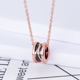 $enCountryForm.capitalKeyWord Australia - Small red book vibrating charity small red man hollow black and white ceramic couple necklace chain female jewelry manufacturers wholesale h