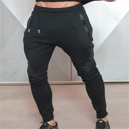 Muscle Print Pants Australia - Muscle Fitness Mens Long Pants Casual Printed Cotton Trousers Exercising Bodybuilding Gyms Breathable Pencil Pants
