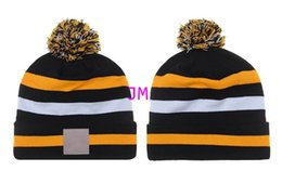 China 2019 hot sale luxury fashion knitting cotton hats hair ball strips camouflage high quality fashion cheap Beanie cap women's winter warm hats cheap multi strip suppliers
