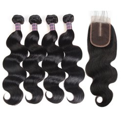 China Indian Water Wave Human Hair Bundles With Closure Peruvian Wet and Wavy Hair 4 Bundles Malaysian Body Wave Deep Loose Hair Extensions cheap natural wavy human hair suppliers