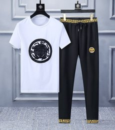tracksuit summer men Australia - Casual Suit Sweat Suits Jogger 2019 New Summer Silk Cotton Fashi Lapel Collar Short-sleeved T-shirt Long Pants Mens Tracksuits Size M-XL4