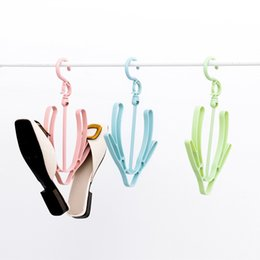 $enCountryForm.capitalKeyWord Canada - A clothes rack for drying shoes. A small drying rack. A wind-proof shoe hook.