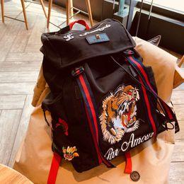 Patchwork Plaid Handbags Australia - 2019 luxury famous 32*43cm quality designer tiger head bags backpack handbag lady Backpacks Laptop Sac à main school men Women Towel 053102