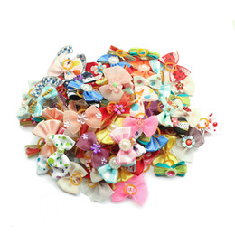 Hair Fall Products Australia - 20 50 100 Pcs Handmade Pet Grooming Accessories Products Dog Bow 6011026 Hair Little Flower Bows For Small Dogs Charms Gift