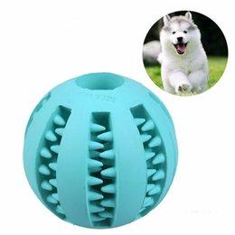 New Pet Dog Toy Palla di gomma giocattolo Funning Light Green ABS Pet giocattoli palla cane masticazione giocattoli pulizia del dente palle di cibo 2.8 pollici 7 cm in Offerta