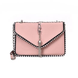 simple handbags Australia - British Fashion Simple Small Square bag Womens Designer Handbag 2019 High-quality PU leather Rivet Tassel Chain Shoulder bags