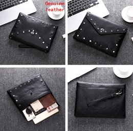 $enCountryForm.capitalKeyWord NZ - Factory wholesale men handbag personalized rivet punk hand clutch bag new leather business wrist baotou leather rivet fashion envelope bag