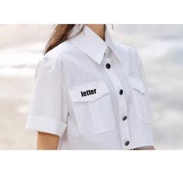 48ab992212 Nueva llegada mujer diseñador carta camisa blanca verano blusa de manga  corta con sello moda algodón camisa S M L