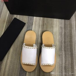 Genuine Leather Soft Moccasins Australia - Summer new flat bottom Beach Fashion slip Soft Genuine Leather Wearing Simple temperament Super easy Woman slippers