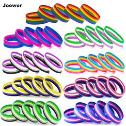 Ingrosso Braccialetti di gomma di sport dei braccialetti di gomma del silicone di gay organza di LGBT
