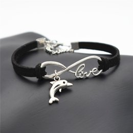 silver dolphin bracelet NZ - Hot Fashion Women Men Beach Cute Animal Lovely Tibetan Silver Dolphin Charm Infinity Black Leather Suede Bracelets Family Love Gifts Jewelry