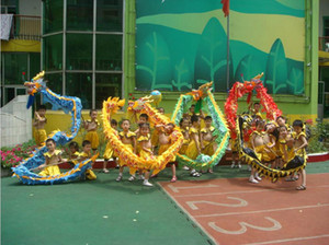 Tissu imprimé en soie rouge enfant CHINESE Kid DRAGON DANCE Costume de fête Folk Festival Costume dragon mascotte