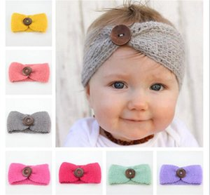 Nueva Baby Girls Fashion Wool Crochet Headband Knit Hairband con decoración de botones Invierno Recién nacido Bebé Ear Warmer Head Headwrap R075