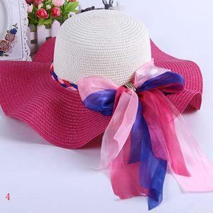 Mode d'été Femmes / Femmes Grandes Straw Hat Big Lace Bow plage Caps Sun Visor Derby large Brim chapeaux filles Randonnée large Brim chapeaux ZJ-M02