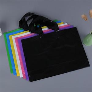 Logo personnalisé imprimé en plastique emballant des sacs à provisions avec la poignée, sac d'emballage personnalisé de vêtement / habillement / cadeau LZ0773