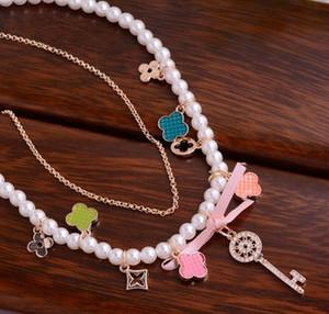 dimaond key pendant (3*1cm) pearl chain necklace (xgspc)