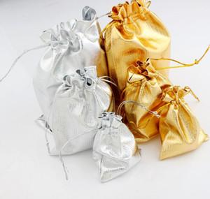 Gauze Satin Bolsas de joyería Joyería 100pcs / lot Silver / Gold Chaped Chraped Christmas Bols Bag 7x9cm 9x12cm 13x18cm
