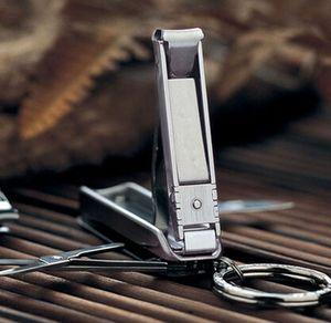 Wholesale-5 in 1 Edelstahl-Multifunktionsschlüsselanhänger Folding Finger Schere Zange Werkzeug-Messer-Nagelknipser Schere Klinge # A41
