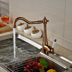 Wholesale and Retail Promotion Polished Rose Golden Deck Mounted Kitchen 수도꼭지 Swivel Spout 세라믹 핸들 온수 및 냉수