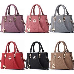 Британская мода ретро женщина сумки 2020 Pu Leather Luxury сумки Женские сумки конструктора Rivet Tote девушки плеча Сумка Z07 # 843