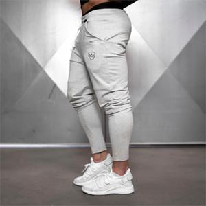 Новые мужские Hip Hop Sweatpants Фитнес Joggers Spring Мужской Side нашивки High Street Hip Длинные брюки шаровары Sweatpant моды