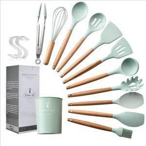 INS Hot Vente en silicone Ustensiles de cuisine Set antiadhésif Spatule Pelle poignée en bois Outils de cuisine avec espace de rangement Boîte de cuisine Outils
