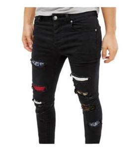 Mens Fori Strappato Jeans Slim nero di modo Rapper Hiphop Skateboard elastico Jean Pantaloni Pantaloni