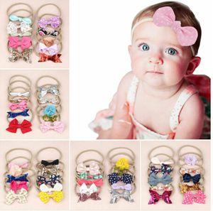 Envío libre 10pcs niños Hairbands Soild del color del Bowknot Cinta elástica de nylon de los bebés Headwear de la venda del pelo Accesorios para el cabello